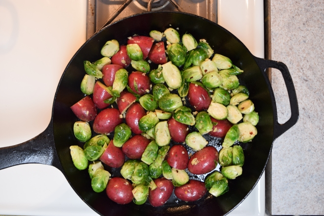 brussels sprouts and potatoes in a cast iron skillet
