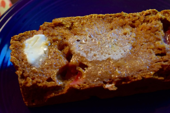 whole wheat pumpkin bread with melted butter