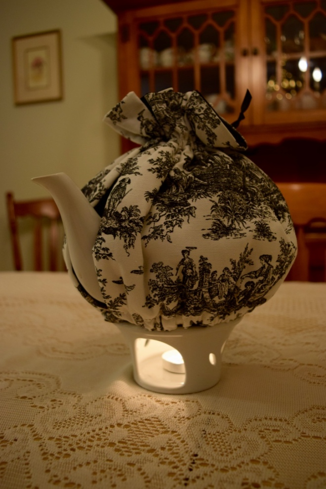 teapot with warmer and tea light